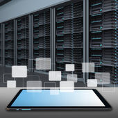 Tablet computer and data center server room — Stockfoto