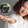 The earth globe in hand — Stock Photo