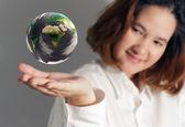 The earth globe in hand — Stock Photo