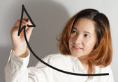 Businesswoman drawing a rising arrow — Stock Photo
