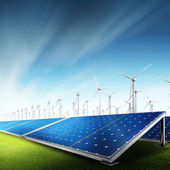 Powerplant with photovoltaic panels and eolic turbine — Stock Photo