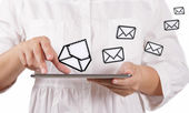 Tablet computer and email icons — Stock Photo