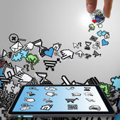 Tablet computer with pixel computer icons — Stock Photo