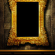 Gallery display - vintage gold frames on an old timber wall — Foto de Stock