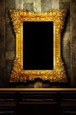 Gallery display - vintage gold frames on an old timber wall — Stock Photo