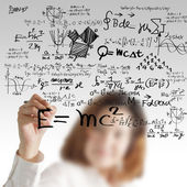 Female draws maths and science formula — Stock Photo