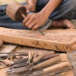 Stock Photo: Traditional craftsmcarving wood