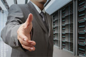 Businessmen offer hand shake in a technology data center — Stock Photo