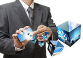 Businessman using touch screen mobile phone streaming 3d images — Stock Photo