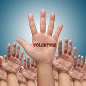 Volunteer group raising hands — Stock Photo