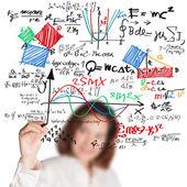 Lehrerin schreiben verschiedene High School Mathematik und Naturwissenschaften für — Stockfoto