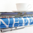 A coffee cup and newspaper background — Stock Photo #13120606