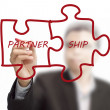 "Businessmdrawing ""partnership"" written puzzle pieces — Stock Photo #13121967"