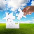 Stock Photo: Hand complete puzzle home as concept