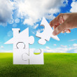 Hand complete puzzle home as concept — Stock Photo