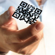 Business hand shows 3d Qr code — Stock Photo #13122127