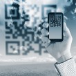 Scanning Qr code with mobile smart phone — Stockfoto