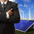 Business man success with energy saving - Stock Photo