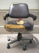 Damaged office chair — Stock Photo