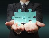 "Businessman shows ""3d partnership"" written puzzle pieces — Zdjęcie stockowe"