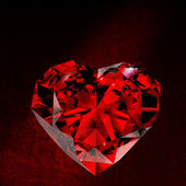 Shiny red diamond on dirt background — Stock Photo