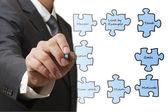 Businessman draws puzzles — Stock Photo