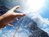Hand reach the sun concept renewable, alternative solar energy, — Foto de Stock