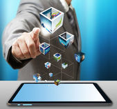 Business man use tablet computer streaming images — Stock Photo