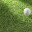 Stock Photo: Golf ball on green