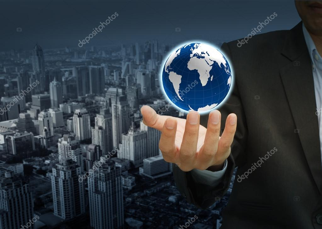 Holding a glowing earth globe in his hands  Stock Photo #13143133