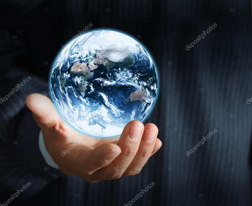 Holding a glowing earth globe in his hands — Stock Photo #13149872
