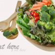 Wooden bowl of mixed salad - Stock Photo