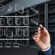 Stock Photo: Business mhand draws internet system chart