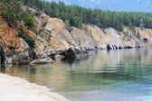 Sandy beach among the rocks of Lake Baikal — Stock Photo