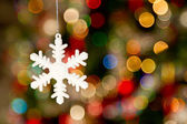 White star on bokeh tree — Stock Photo