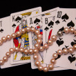 Stock Photo: Beads on playing cards