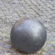 Photo: Iron ball on cobblestone