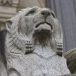 Lion statue on church — Stock Photo