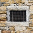 Stock Photo: Old lattice window in wall