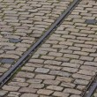 Old tram rails on cobblestone — Stock Photo