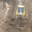 Stock Video: Yellow Bulldozer Raking Clay