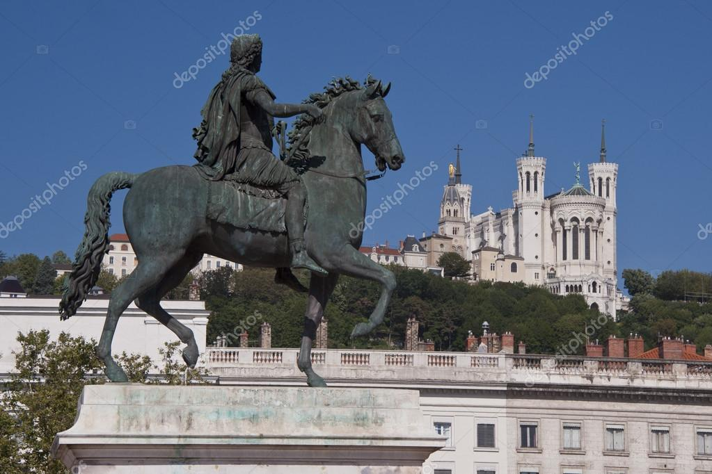 View of the equestrian statue of louis xiv and the basilica of notre dame de fourviere from place bellecour, in the center of lyon  — Lizenzfreies Foto #12971459