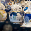 Decorated christmas balls and bell — Stock Photo #13261773