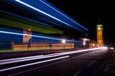 Blue and white traffic lights on the westminster bridge — Stock Photo