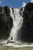 Dinghy under the the Iguazu Falls — Stock Photo