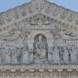 Statues on facade of notre dame de fourviere — Stock Photo #18685597