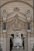 Lyon on the facade of notre dame de fourviere — Stock Photo