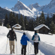 Family Hiking on a snowy Trail — Stockfoto