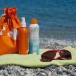 Suntan Creams on a Beach Towel — Lizenzfreies Foto