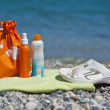 Suntan Creams on a Beach Towel — Stock Photo